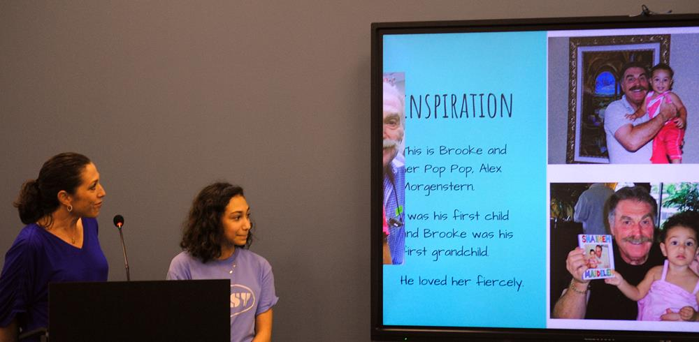 Brooke Diamond presents her sunscreen project to the District.